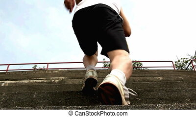jogging - male jogging up stair for health