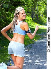 Jogging woman. - Young woman jogging in park. Health and...
