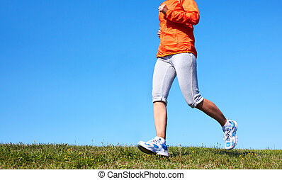 Jogging woman. - Young woman jogging in the park. Health and...