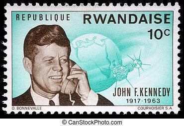 John Fitzgerald Kennedy - A stamp printed by Rwanda, shows...