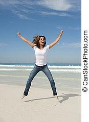 joie, femme, plage, jeune, sauter