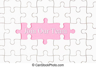 Join Our Team text with white jigsaw puzzle board.