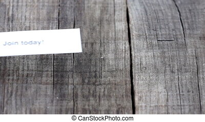 Join Today - A Join Today paper sign on wood background