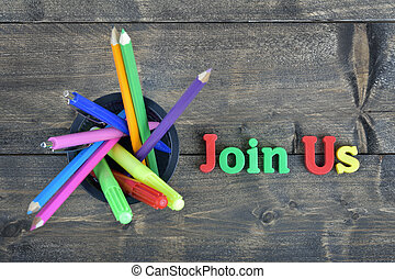 Join Us on wooden table