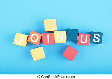 JOIN US word on wooden cube over blue background for recruitment ,membership or hiring concept