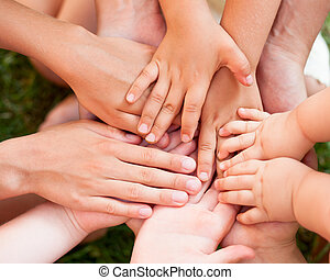 Joined hands - Family holding hands together closeup