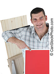 Joiner pointing to red poster board