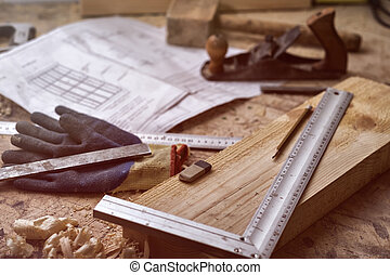 Joiner table: marking the board according to the drawing before working. Various tools: plane, line, gloves, pencil