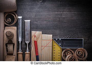 Joiners tools on wooden board construction concept