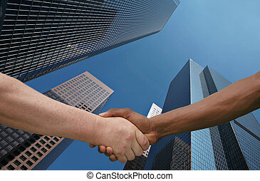 Joining Forces - Two Men of Different Ethnicities Shaking...