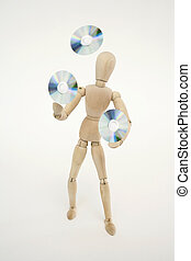 Jointed doll juggling with cds, isolated on white background
