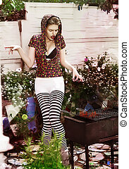 Joke. Eccentric Crazy and Funny Woman Hipster cooks Barbecue on Bbq Grill