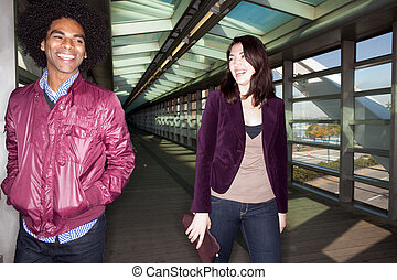 Joke Fun Couple - Two young people walking and joking in an...