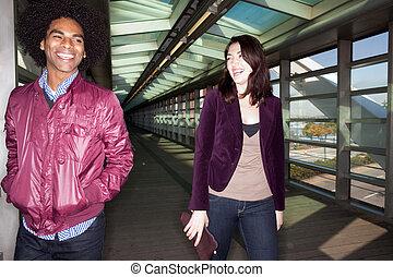 Joke Fun Couple - Two young people walking and joking in an ...