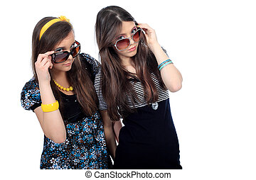 joke - Two modern girls teenagers. Isolated over white...