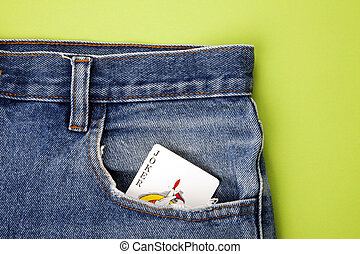 Joker playing card in blue jeans pocket
