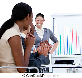 Jolly business team applauding in a meeting