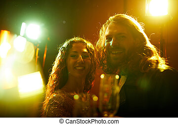 Jolly couple at party