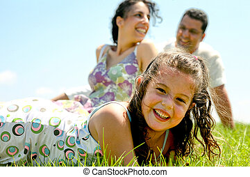 Jolly family - Close-up of young kid with parents relaxing...