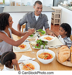 Jolly family dining together in the kitchen