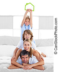 Jolly family having fun with green house illustration in the...