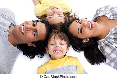 Jolly family lying together on the floor in circle against a white background