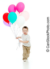Jolly funny child boy with bunch of colorful ballons in his hand. Isolated on white.