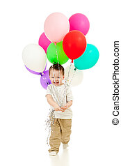 Jolly funny child boy with bunch of colorful ballons in his hands. Isolated on white.