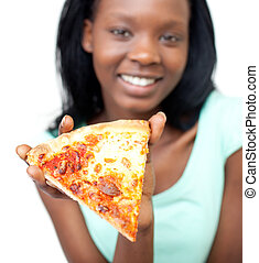 Jolly teen girl holding a pizza