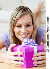 Jolly woman holding a gift