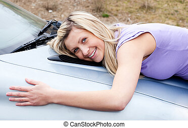 Jolly young driver huging her new car - Jolly young female...