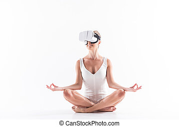 Jolly youthful sporty woman recreating with help of vr ...