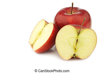 jonagold apple and two halves on a white background