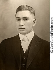 jonah - antique photograph of young man in suit tie and vest