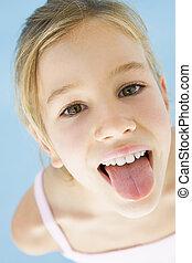 jong meisje, kleverig, haar, tong uit