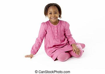 jong meisje, zittende , in, studio