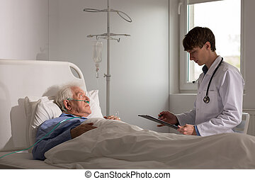 jonge arts, klesten, met, patiënt