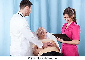 jonge, artsen, klesten, met, patiënt