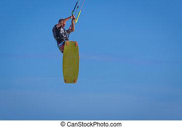 jonge, atletic, man, paardrijden, vlieger, branding, op, een, zee