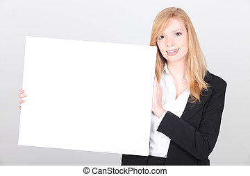 jonge, businesswoman, met, een, plank, links, leeg, voor, jouw, boodschap