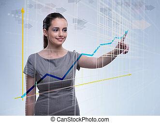 jonge, businesswoman, met, tabel, diagrammen