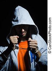 jonge, crimineel, met, handcuffs