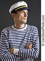 jonge, de mens van de zeeman, met, witte , de hoed van de zeeman
