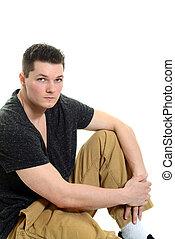 jonge man, aantrekkelijk, zittende