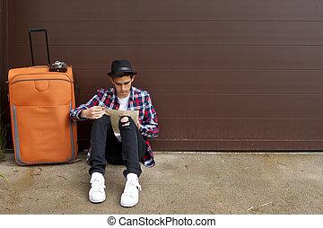 jonge man, gereed, aan reis