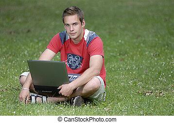 jonge man, met, aantekenboekje