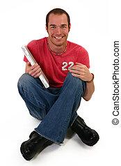 jonge man, met, draagbare computer, zit, op, vloer