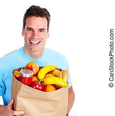 jonge man, met, een, grocery boodschapend doend, bag.