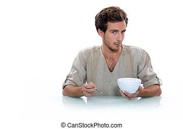 jonge man, met, een, ontbijt, kom