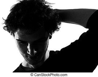 jonge man, silhouette, verdrietige